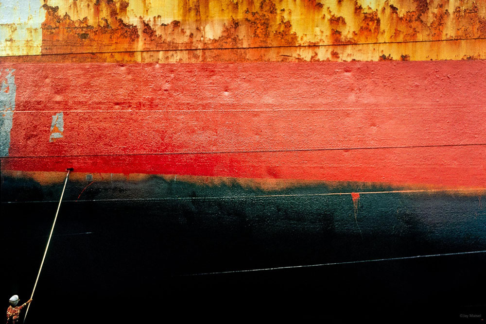 'Man Painting Ship' photography by Jay Maisel