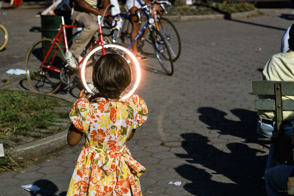 'Girl with Bicycle Halo' photography by Jay Maisel