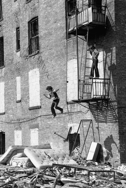 © Martha Cooper, Boy Jumping from Fire Escape, Lower East Side, 1978
