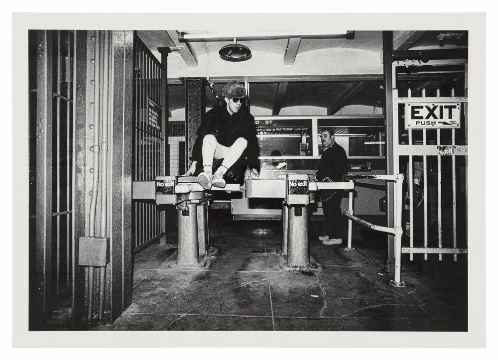Futura jumping turnstyle, July 1983. © Sophie Bramly
