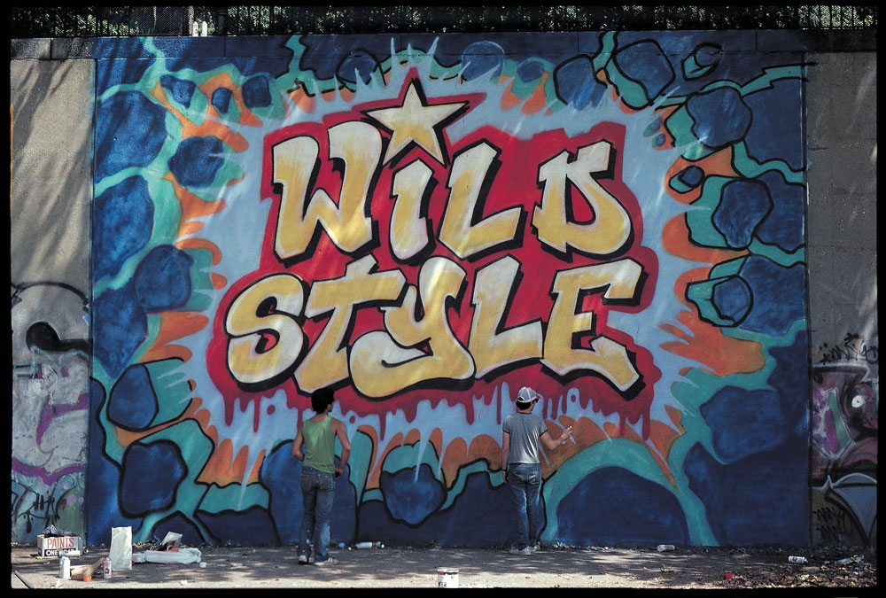 Sharp and Revolt finish the Wild Style mural, 1983. Photo © Martha Cooper.