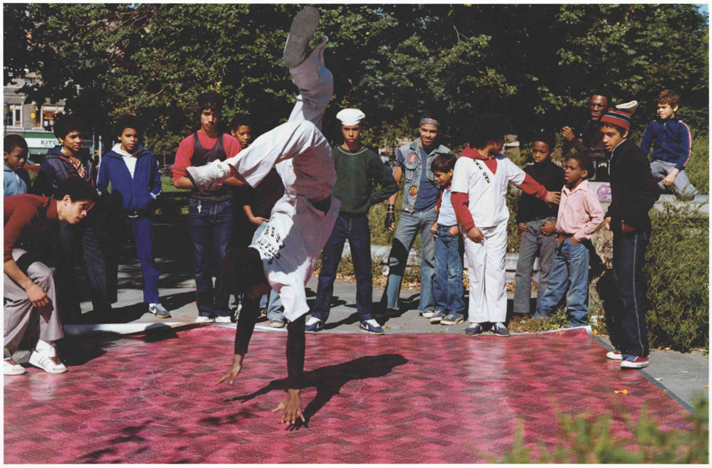 """The Rock Steady Crew rolled out the red vinyl mat in the South Bronx Crotona Parks scene and busted moves for the camera, like Frosty Freeze'a classic, """"Suicide,"""" 1981. Photo © Cathy Campbell."""